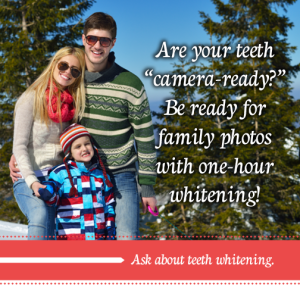 A young family standing outside in sweaters smiling because they brightened their smiles with teeth whitening in Scottsdale, AZ