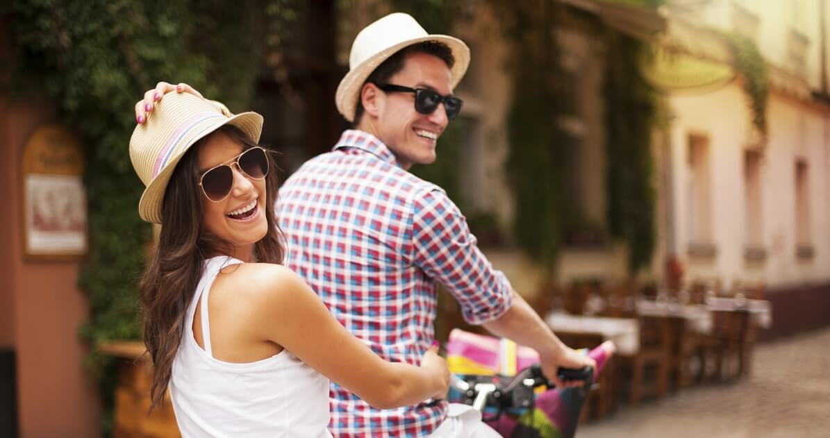 Young couple riding a bike.