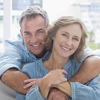An older couple smiles to show what a smile make-over from Dr. Graber can do for you.