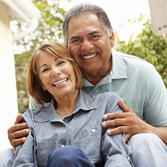 An older couple smile to show how porcelain crowns can give you back a bright smile