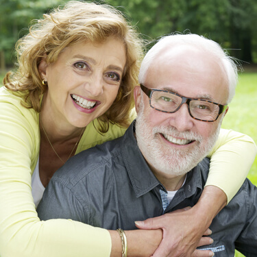 Scottsdale Family Dentistry - older couple hugging and smilng