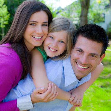 Scottsdale Family Dentistry - family of 3 piggyback ride