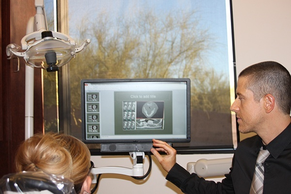 Dr. Graber showing patient xrays on computer