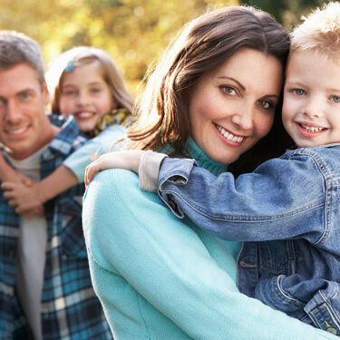 Scottsdale family Dentistry - mother and father holding children