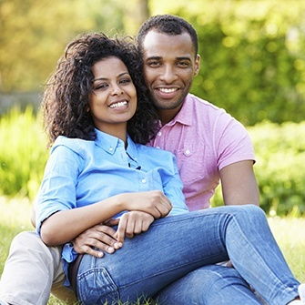 A couple smiling to show how Invisalign discreetly straightens your smile.